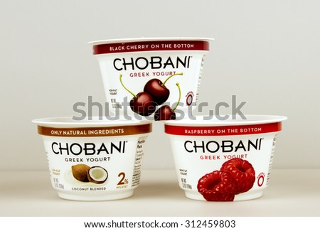 RIVER FALLS,WISCONSIN-SEPTEMBER 02,2015: Several containers of assorted flavored Chobani greek yogurt. - stock photo