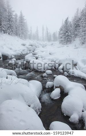 river flowing among stones in the mountains - stock photo