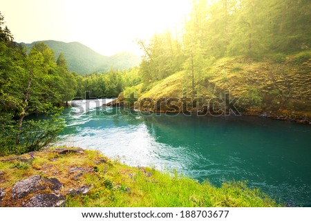 River in mountains - stock photo