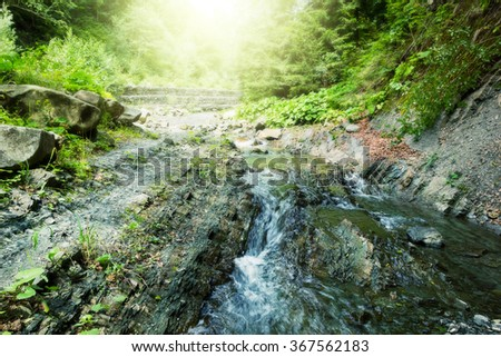 River in mountains forest. Beauty nature background - stock photo