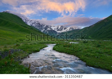 River in the mountains. Colorful sunset with beautiful clouds. Summer landscape. Main Caucasian ridge. Zemo Svaneti, Georgia  - stock photo