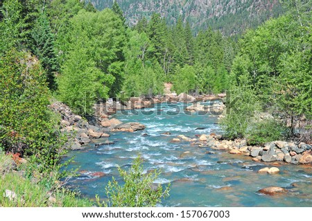 River in the Rocky Mountains - stock photo