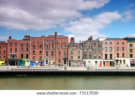 River Liffey and colorful buildings at summer day in Dublin, Ireland - stock photo