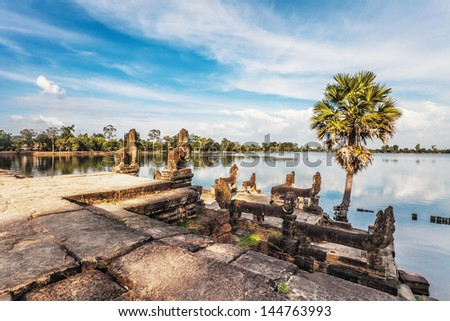 River near ancient buddhist khmer temple in Angkor Wat complex, Cambodia - stock photo