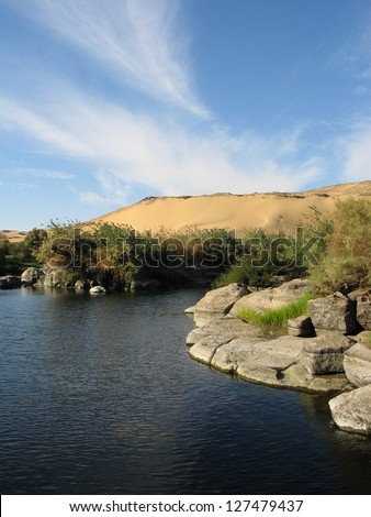 River Nile and the dunes near Aswan in Egypt - stock photo