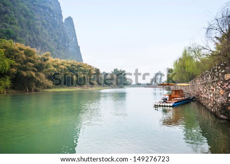 River of Xingping ancient town in Yangshuo County. Yangshuo County is a county under the jurisdiction of Guilin City, located in the northeast of Guangxi Province, China. - stock photo