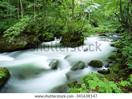 River on green meadow - stock photo