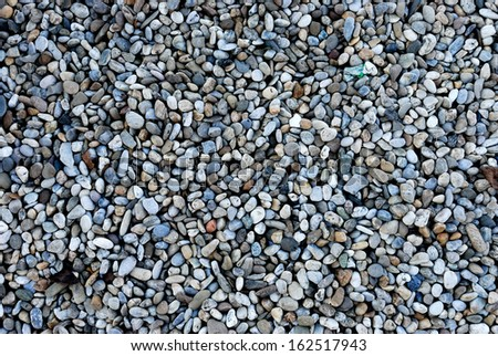River pebbles of different colors - stock photo