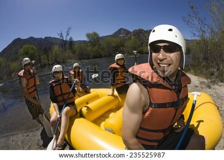 River Rafters Preparing to Launch Raft - stock photo