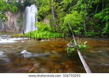 River rapids below Spearfish Falls in the Black Hills National Forest of South Dakota - stock photo