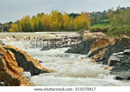 river rapids under cloudy sky - stock photo