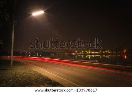 River road at night in Ubon Ratchathani Province Thailand. - stock photo