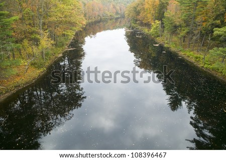 River runs through autumn color of western Massachusetts, New England - stock photo