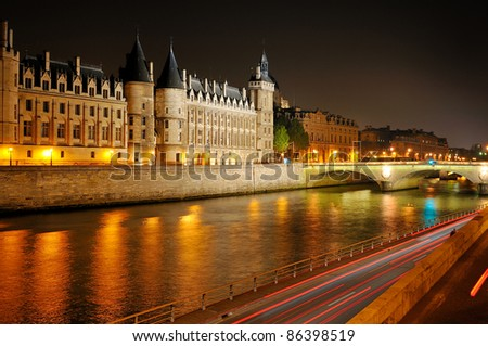 River Seine, palaces and townhouses in Paris night, capitol of France. - stock photo