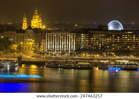 River view of Budapest at evening, illuminated Chain Bridge - stock photo