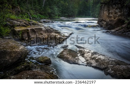 river water running in the stones - stock photo