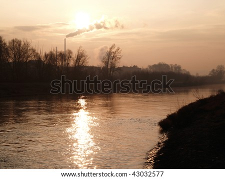 River with factory - stock photo
