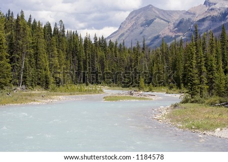 river with glacial water - in the rockies, canada - stock photo