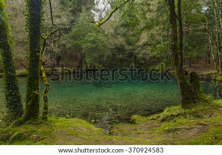 river with green and blue crystal clear waters  - stock photo