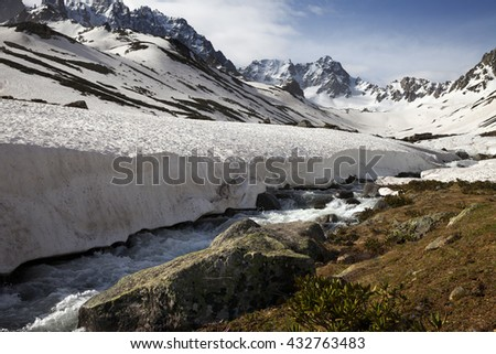 River with snow bridges in spring mountains at sun day. Turkey, Kachkar Mountains (highest part of Pontic Mountains). - stock photo