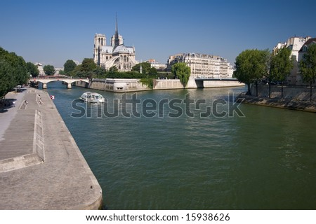 Riverside embankment on the river Seine in Paris on a summers day. - stock photo