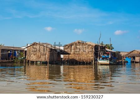 Riverside houses in Mekong delta - Vietnam - stock photo