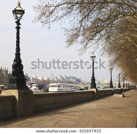 Riverside promenade of Albert Embankment. Lambeth. London. England. With River Thames and Westminster Bridge in background. - stock photo