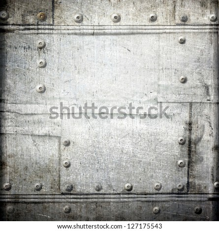 riveted   metal plating ; abstract grunge background - stock photo