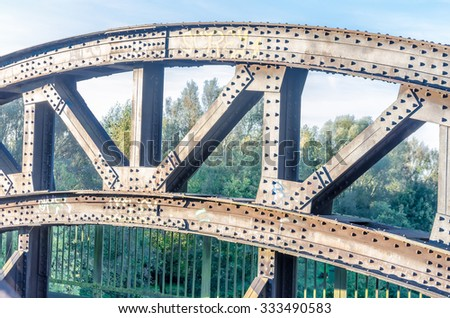 Riveted old bridge arch. - stock photo