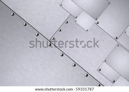 Rivets in sheets of steel - stock photo