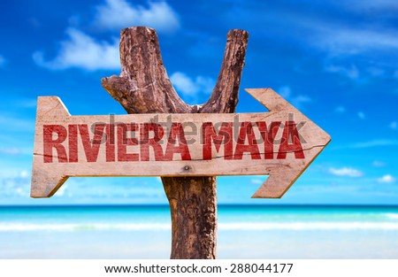 Riviera Maya wooden sign with beach background - stock photo