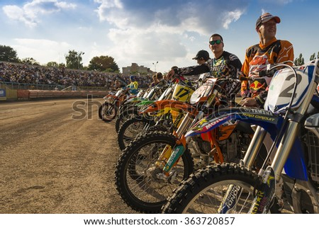 Rivne, Ukraine - 11 October 2015: Unknown riders  during a prepare for the race at the Open Cup Speedway to the day of the city Rivne - stock photo