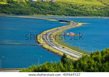 Road accross fjord near airport and city of Akureyri, north Iceland - stock photo