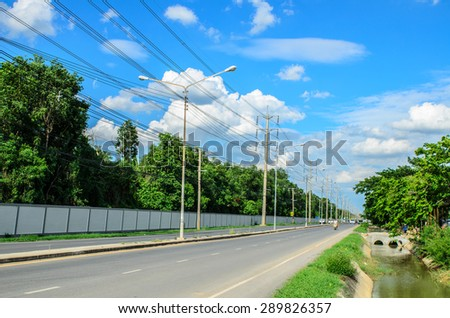 Road and blue sky. - stock photo