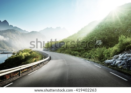 road and mist, Lofoten islands, Norway - stock photo