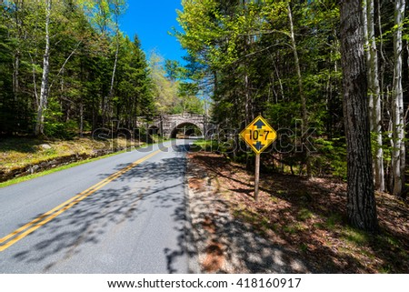 Road and road sign in Acadia National Park, Maine, USA. - stock photo