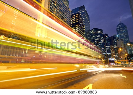 Road and traffic in downtown area - stock photo