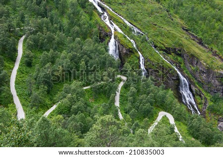 Road and waterfalls in famous Flam (Flåm) valley, Norway - stock photo