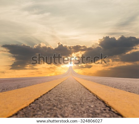 Road asphalt suspended to the sky over sunset - stock photo