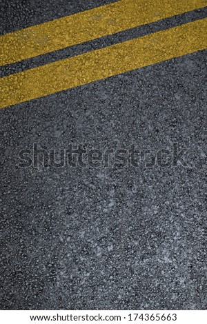 Road asphalt texture with  two yellow lines - stock photo