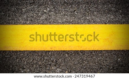 Road asphalt texture with yellow line - stock photo