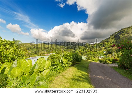 Road at small residential area of Mahe island, Seychelles - stock photo