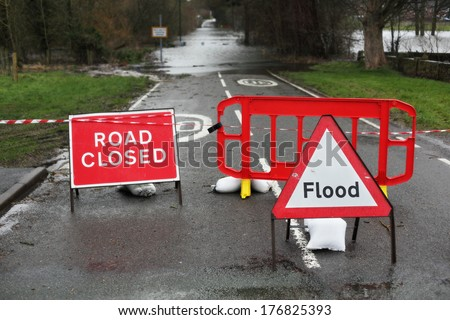 Road closed and flood sign due to heavy rain and floods - stock photo
