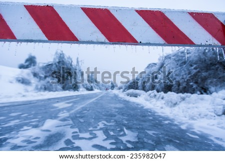Road closed for ice with fallen trees in background - stock photo