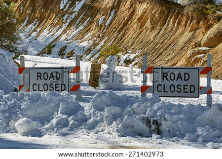 Road closed, mountains, snowman with sign, national park, USA - stock photo