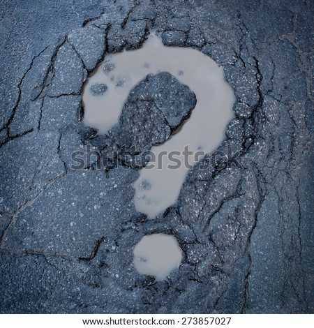 Road construction concept and city maintenance of infrastructure symbol as broken pavement or asphalt shaped as a question mark pot hole or damaged street as an icon for highway safety questions. - stock photo