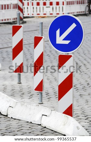 Road construction site with barricades and detour - stock photo