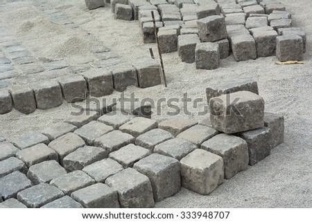 Road Construction Site with Cobblestone and Gravel - stock photo
