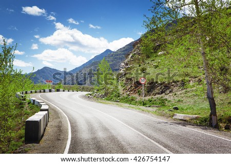 road curve in mountains - stock photo