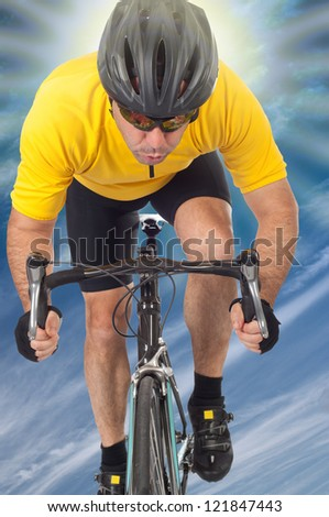 road cyclist riding a bike with a yellow jersey - stock photo